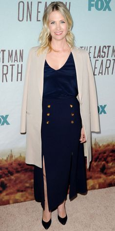 January Jones hit a maritime note at the Fox's screening of The Last Man on Earth in a navy ankle-grazing nautical-inspired skirt that she elevated with a satiny black top, a sharp taupe-colored coat, and black pumps.