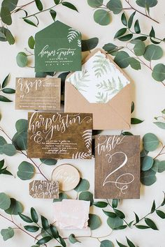 rustic wedding invitations photo by Booth Photographics / http://www.deerpearlflowers.com/greenery-wedding-decor-ideas/3/