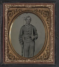 [Unidentified soldier in Confederate uniform with musket and D-guard Bowie knife] (LOC) by The Library of Congress, via Flickr