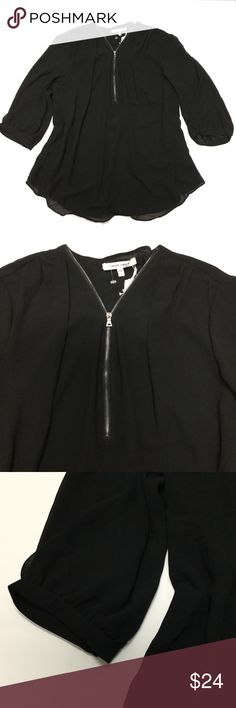 Black Blouse 🎉🎉 $20 Sale🎉🎉 Flowy Dressy Black Blouse.  Features a Zipper in bust area to customize your outfit. lower for a sexy fun night out or zip up for working hours.  NWT. 🎉🎉 $20 Sale🎉🎉 Tops Blouses
