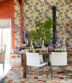 "For the dining room of their Vermont cottage, designers Deirdre Heekin and Caleb Barber combined modern and vintage decor. Heekin wanted the dining room to be ""an assemblage of old and new that expresses the layers of time and living."" The dining chairs are by Licari. The vintage wallpaper is from Second Hand Rose. India wool rug by Indiport.   - HouseBeautiful.com"