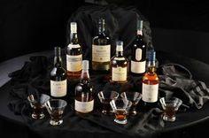 Scotch tasting element. Served in nosing glasses. 1 scotch from each of the 5 regions. With sharp & mild cheeses, unflavored crackers, dark chocolate, and various fruits.