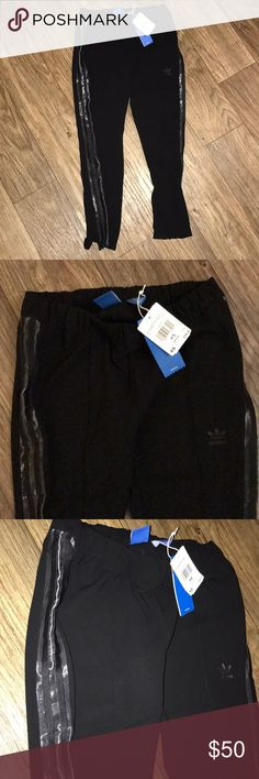 "BNWT Adidas Black Cigarette Track Pant Brand new with tags, size XS, Adidas Black Cigarette pant. Super easy to dress up or dress down! Very flattering fit! Elastic waist laying flat across 13.5"", inseam 23"" Please comment if you need more pictures. Do not buy listings listings from me if you have questions without asking for clarification. Thanks for helping maintain clear communication! Xoxo adidas Pants"