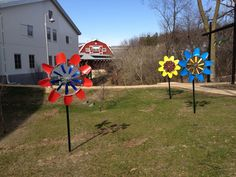 Three kinetic garden Windflowers from WindworkerStudio.com on display at Epic Systems, Verona, WI.