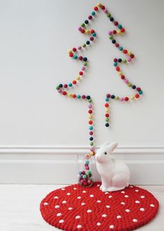 Create an outline of a tree using a rainbow pom-pom garland. 38 Fabulous DIY Christmas Trees That Aren't Actual Trees Unusual Christmas Trees, Creative Christmas Trees, Alternative Christmas Tree, Diy Christmas Tree, Christmas Holidays, Christmas Decorations, Modern Christmas, Winter Holiday, Holiday Decorating
