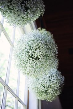 Perfect not only for weddings but parties indoor and out, summer or winter. You don't have to be a florist to do this either. Using an oasis ball, you just stick the baby's breath in and fill it up! At Christmas add some color by including cranberries, holly and springs of pine and or cedar!