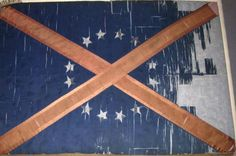 This is the battle flag of Alabama Regiment of the War Between the States. It is identical to the Saltire of Scotland except for the stars around the cross. A large percentage of Southerners are of Scottish heritage.