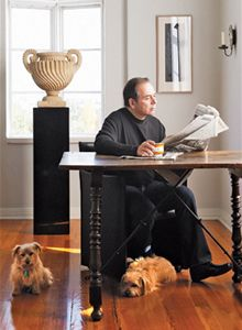 Vitale shares the living room with Norfolk terriers Claiborne and Clara. He discovered the 18th-century carved-stone urn seven years ago at a Santa Fe estate sale.     Photographs by Joe Schmezler