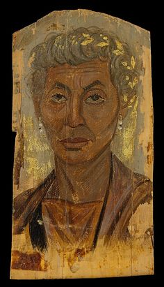 Portrait of an elderly lady with a gold wreath  Period: Roman Period Date: A.D. 100–125 Geography: Egypt Medium: Encaustic, limewood