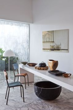 """CUIR CUIR collection chairs by Luc Vincent & white table """"Lange Jan"""" designed by Jan Hoet."""