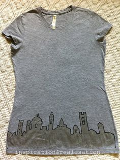 diy shirt with cityscape along the bottom.  Cute – could also do a forest silhouette thing :)