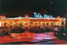 San Francisco. Mel's Drive In, an icon from days gone by.  My parents took my brother and sister and I to the original Mel's drive-ins many times.  Several times we ate in the car.  Out from the restaurant she'd come, a beautiful girl on roller skates with our tray full of food.  Top that for a dining experience!