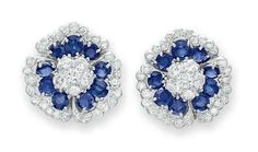 """A PAIR OF SAPPHIRE AND DIAMOND """"CAMELLIA"""" EAR CLIPS, BY VAN CLEEF & ARPELS  Each designed as a flower, with a circular-cut diamond cluster pistil, extending oval-cut sapphire petals, trimmed by a circular-cut diamond scalloped trim, mounted in platinum  Signed Van Cleef & Arpels, N.Y., no. 44315"""