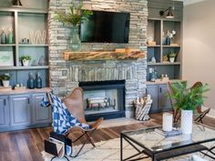 In the remodeled space, a rustic wood mantel provides a visual counterpoint to the gray stone of the fireplace. The trim is simplified and toned down, and new recessed lighting and sconces give the room an inviting glow.
