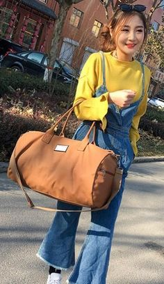 Casual Stylish Woman With Brown Classic Duffel Bag - Front View Travel Specials, Fashion Bags, Womens Fashion, Canvas Backpack, Preppy, Woman, Stylish, Duffel Bags, Classic