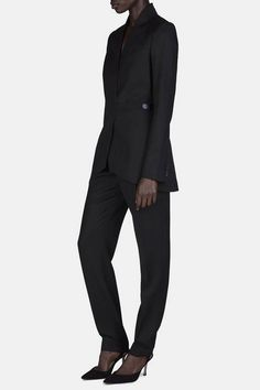 With a high-waisted, gently tapered fit, these sleek trousers cut a striking silhouette, demonstrating the meticulous tailoring of Paris-based atelier Pallas. The black grain de poudre wool is accented by tuxedo-inspired touches of satin that elevate the classic pant with a distinctly luxurious touch. With a trouser waistband and side pockets, the zip-fly style is shaped by waist darts.