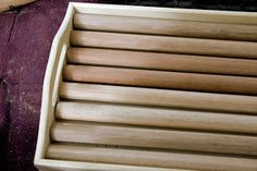 tray with dowels = display stand for earring cards
