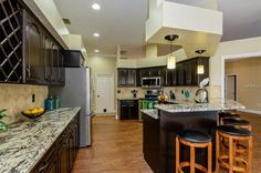 Traditional Kitchen with Trestle BB12 Tile, Whisper White Granite Countertop, Fairlane Cathedral Cabinets