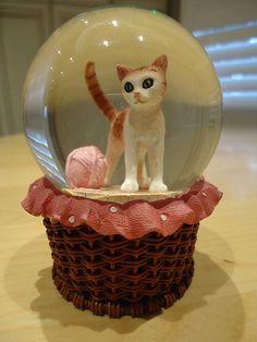 Cat in a basket snow globe by Helen725, via Flickr