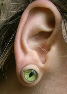 I might have to make some of these earrings for next Halloween. acrylic eyes and some self hardening clay (ear ring posts and backs) everything from the craft store.