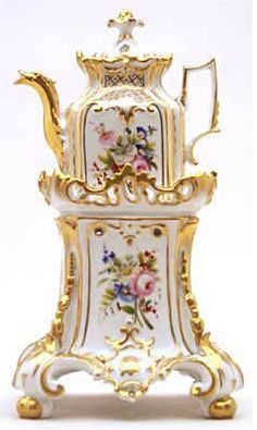 Teapot #405  Square, white with gold trim, panels of roses on two sides, other panels gold, conforming pot   with same decorations, rococo base.  Acquired in Paris