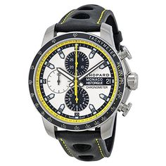 Titanium and steel case with a black leather strap. Fixed silver-tone bezel with black top ring showing tachymeter markings. Silver dial with luminous hands and index hour markers. Minute markers. Tac...