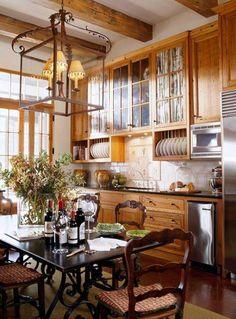 Kitchen: medium stain cabinets and white backsplash.