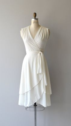 Vintage 1970s cream wrap dress in lightweight and washable polyester with gathered shoulders and multilayered skirt. --- M E A S U R E M E N T S ---