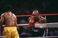 American boxer Marvelous Marvin Hagler pictured right in dark shorts in action against fellow American boxer Thomas Hearns in yellow shorts in a. Marvelous Marvin Hagler, American Boxer, Caesars Palace, Sport Inspiration, Yellow Shorts, Martial Arts, Las Vegas, Action, Dark