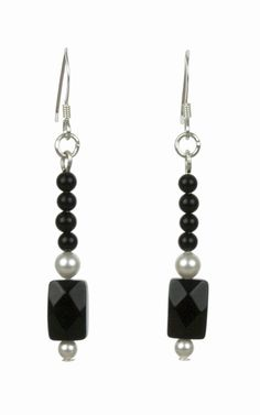 The Elegant Black and White Silver Earrings are from the Elegant Essentials Collection by Lee Buchanan Jewelry. Dainty and delicate, the earrings are perfect for day-to-evening wear and will complement many outfits in your wardrobe. The dangle earrings will add a special touch to any outfit and include a Black Onyx Faceted Rectangle, four Black Onyx Round Beads and two Swarovski White Pearls on sterling silver ear wires. Add this elegant pair of earrings to your jewelry wardrobe today!