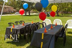 """For my dad's 60th birthday party - black tablecloths with """"parking stalls"""" and pylons. Hiliarious!"""
