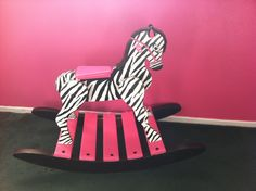 Wooden thrift store rocking horse painted with black and white and pink paint and a lot of love for my granddaughter!