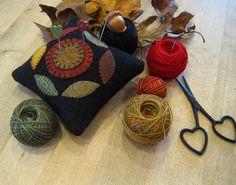 Pin cushion with leaves and pennies