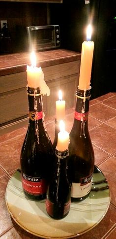 wine bottle candles, really nice table decorations. :D DIY