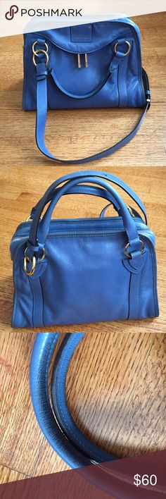 MARC JACOBS HANDBAG Unique blue handbag with additional shoulder/crossbody strap. Gold tone hardware with some of the zipper pulls still wrapped in clear protective plastic. Real genuine leather. Some discoloration on handles and liner and a small pen mark from use. In good condition. Comes from a pet and smoke free home. OFFERS WELCOME. Marc Jacobs Bags Satchels
