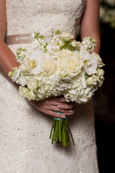 White bridal bouquet with Tiffany blue ribbon - roses, hydrangeas, and orchids