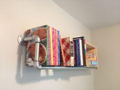 Galvanized pipe shelf for cookbooks.