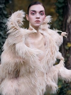 "stormtrooperfashion:  ""Magda Laguinge by Jumbo Tsui for Harper's Bazaar China, December 2013  ""  A soft, angelic impression, contrasting with the almost grotesque closer inspection of bird features, starving, thin, decaying, racing outwards - away?..."