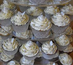White and Silver Wedding Cupcake Tower   A vanilla giant cupcake topped with a cascade of white roses and butterflies.   Vanill...