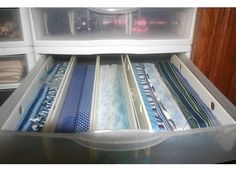 Larger ribbon wrapped around ribbon boards and stored in clear 12 by 12 drawers.