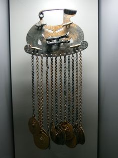 Fibula brooch with hanging disks and animal figures, Hallstatt