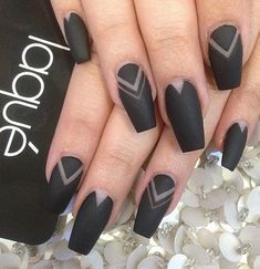 Level up your matte black nail look with chevron patterns.