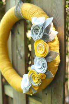 Items similar to Yellow yarn wreath with gray and white felt flowers - The Stephanie on Etsy Felt Flower Wreaths, Ribbon Wreaths, Pom Pom Wreath, Felt Wreath, Easter Wreaths, Felt Flowers, Pom Pom Crafts, Yarn Crafts, Felt Crafts