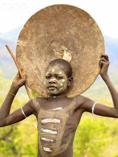 Africa   Surma boy.  Omo Valley, Ethiopia   © Marcos Lira