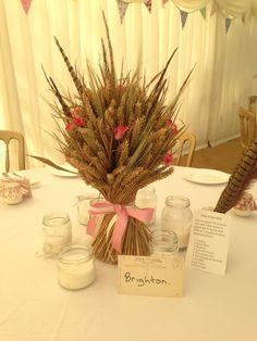 www.signature-flowers.co.uk Everlasting tabelcentre Centrepieces Wheat, barley and Pheasant feathers Wedding Tables Country Wedding