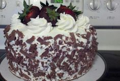 Chocolate Cake with Whipped Cream Frosting, and Strawberry Cream Cheese Filling!
