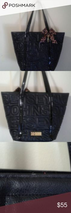 NWOT Betsey Johnson tote. New, Never used black Betsey Johnson large tote. It does have small nick as shown in pic 3, dont know what happened since its been hanging in my closet. Betsey Johnson Bags Totes