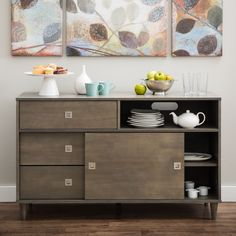 With Mid-century influence, the Marley Buffet is designed in a light charcoal grey finish. This sleek design houses spacious drawers and shelves, each complemented with decorative metal pulls.