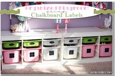 An organized playroom using chalkboard labels to help toy storage stay organized from www.realcoake.com