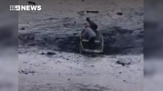 Sinkhole sucks in lake – and nearly two men in a boat